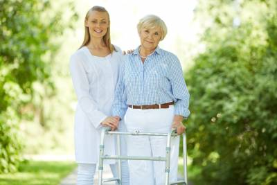 Young-Caregiver-with-Elderly-Woman