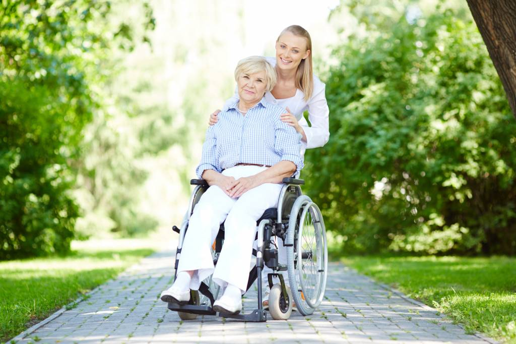 Caregiver-with-Elderly-Woman-in-Wheelchair