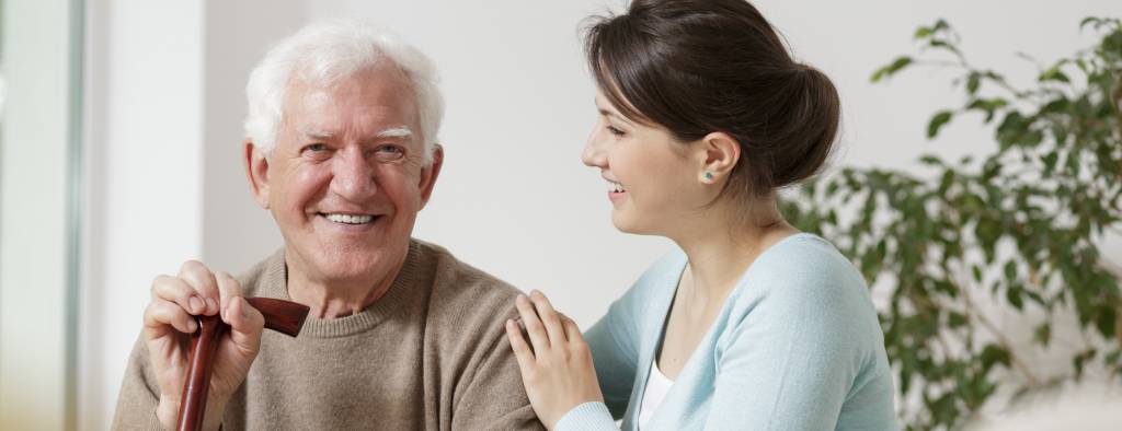 Young-Caregiver-with-Elderly-Man