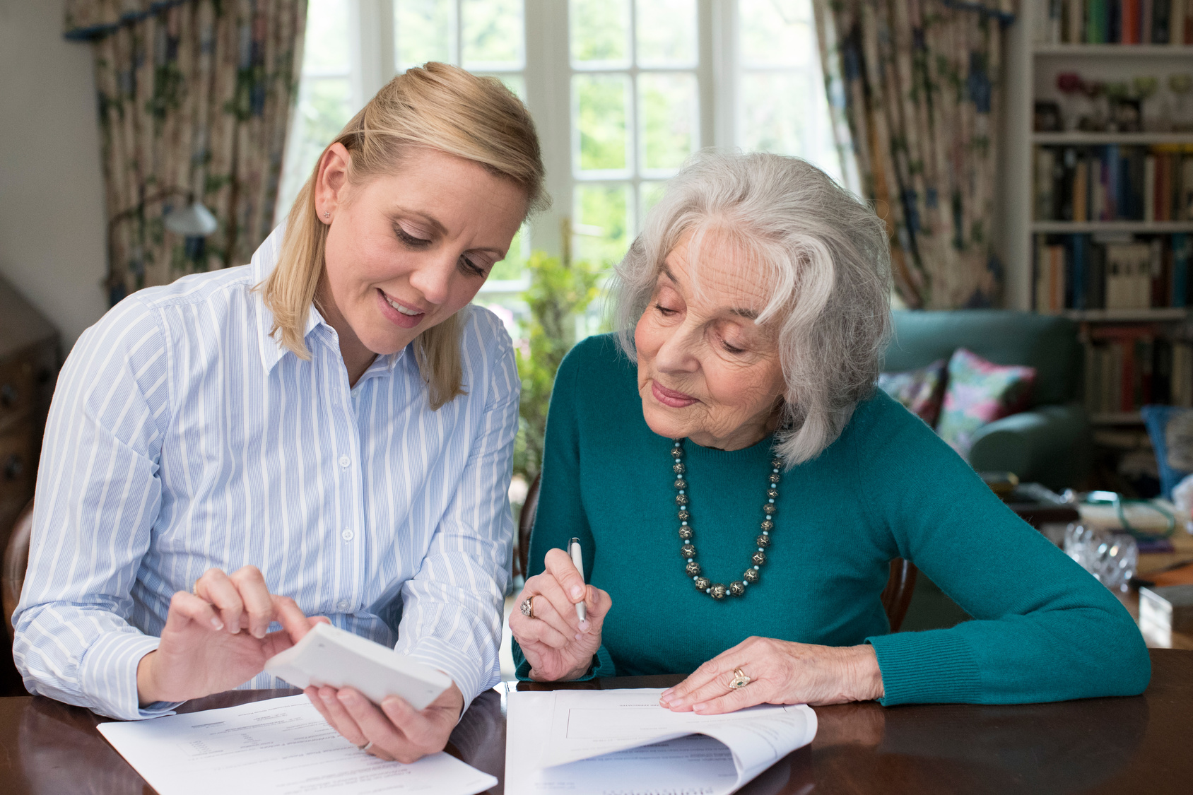 Caregiver-Elderly-Woman-Reviewing-Taxes