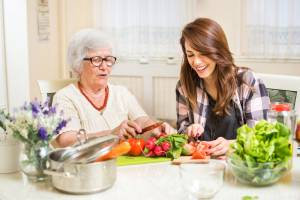 Senior-Caregiver-Cutting-Vegetables