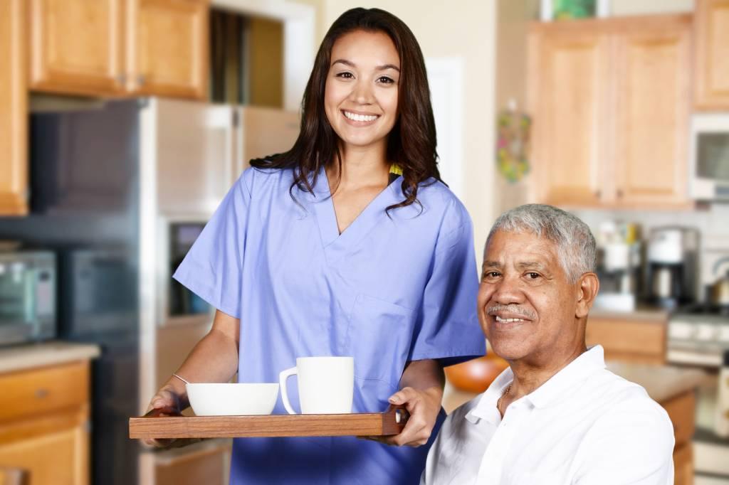 Caregiver-Serving-Senior-Breakfast