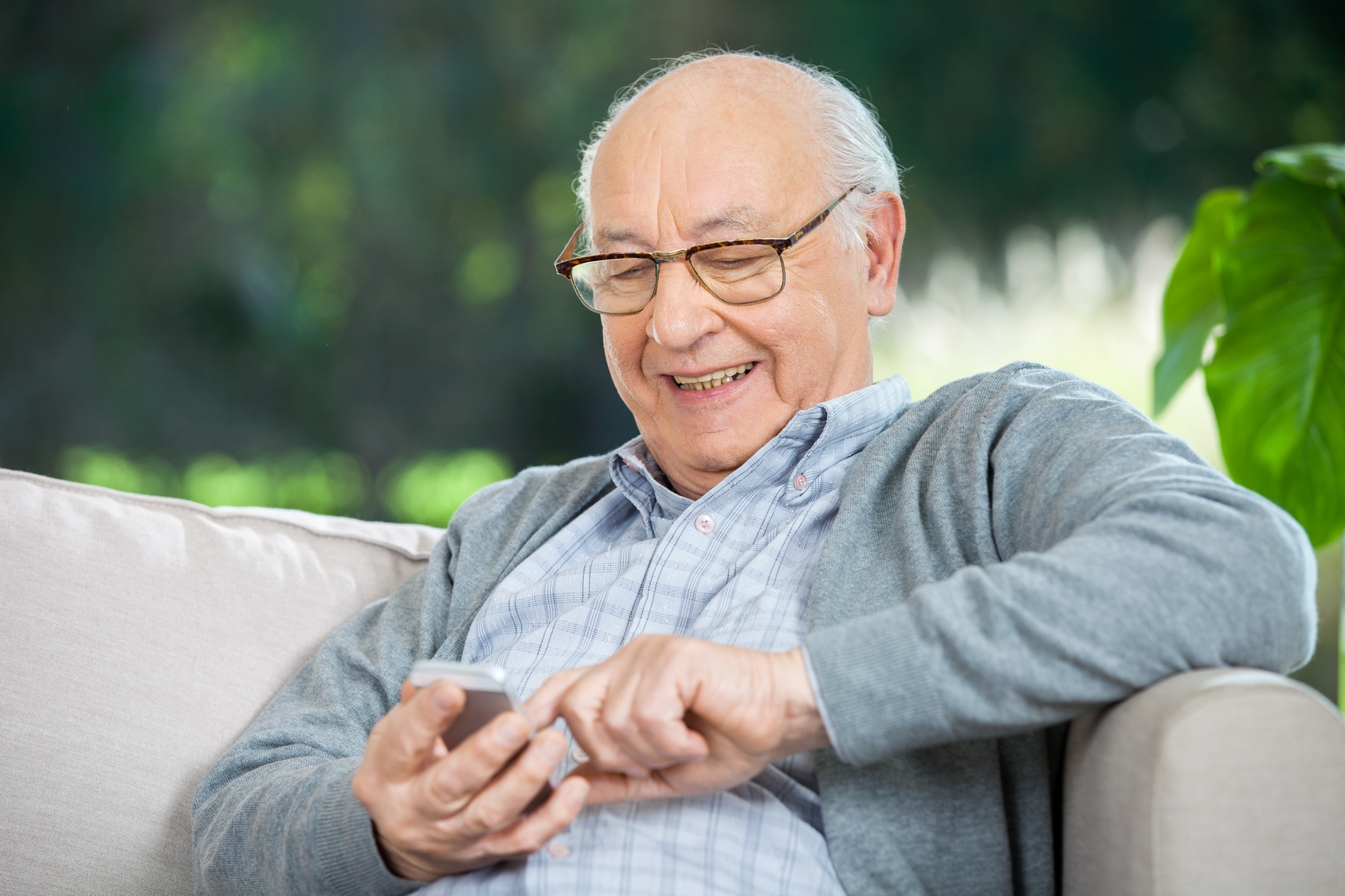 Elderly-Man-Using-Phone-Happy
