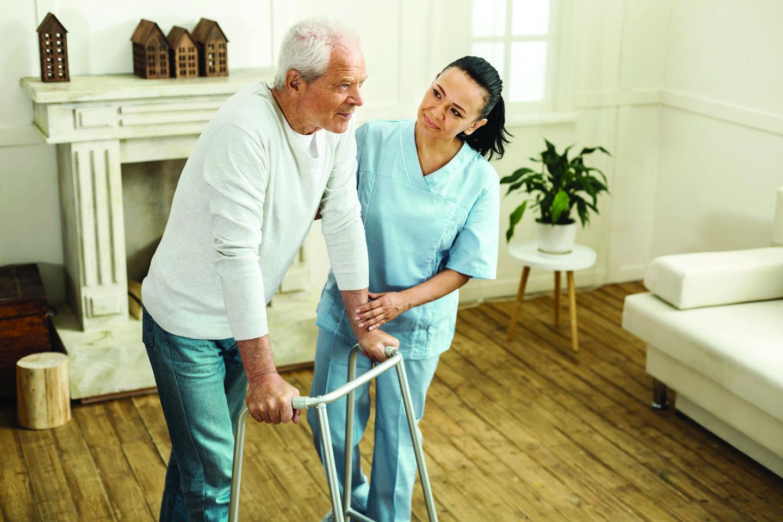 Caregiver-Helping-Patient-Walk