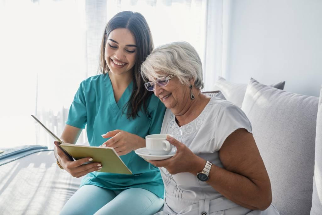 Caregiver-Senior-Reading-Drinking-Coffee