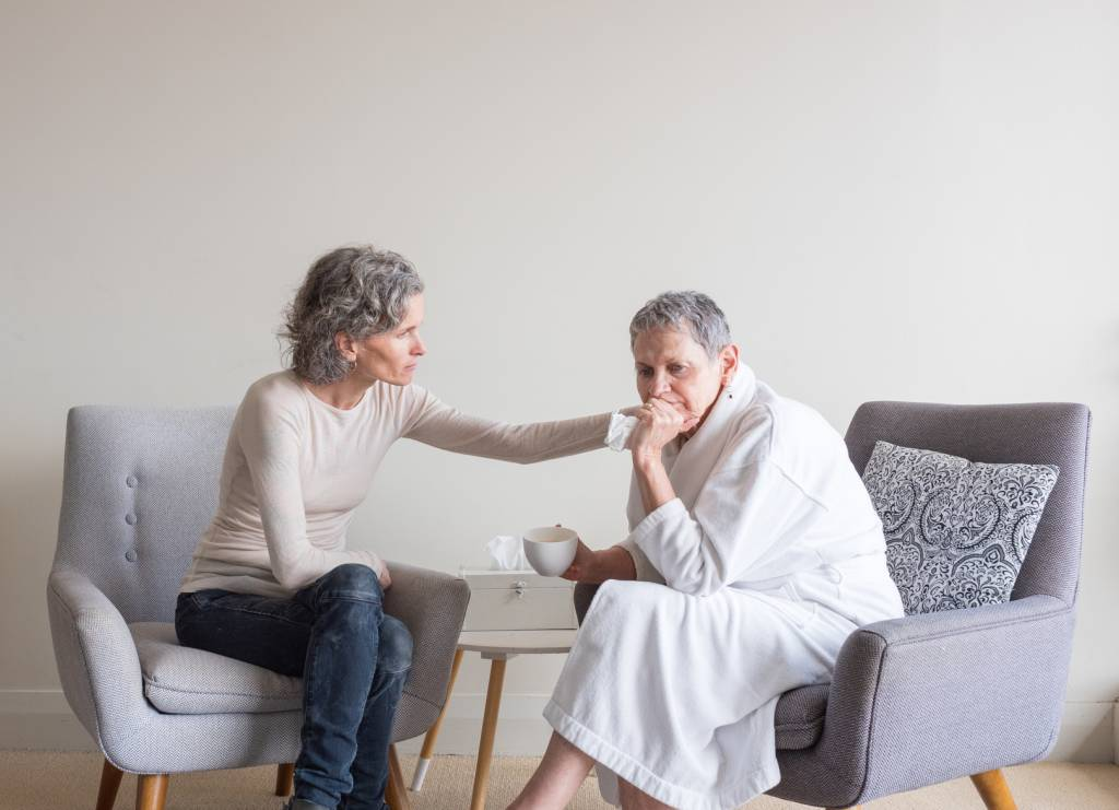 Woman-Helping-Senior-with-Anxiety