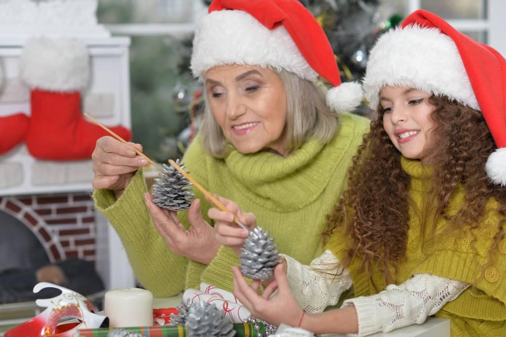 girl with grandmother preparing for Christmas